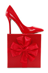 Red high heels pump shoe on gift