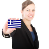 business woman holding a card with the Greek flag