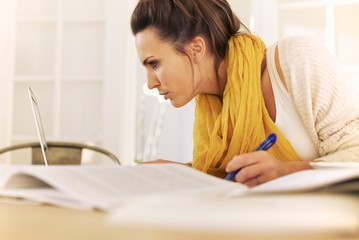 College Student Busy with Home Study