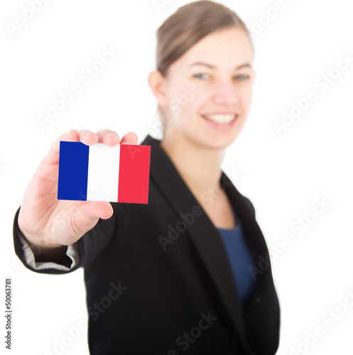 business woman holding a card with the French flag