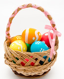 Colorful painted easter eggs in basket isolated