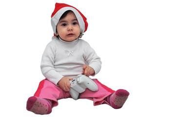Bambina col cappello di Natale che gioca ad un videogame