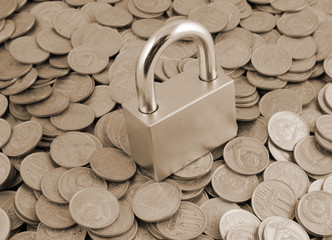 Padlock on coins background