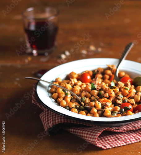 Portion of chickpea stew with cherry tomatoes
