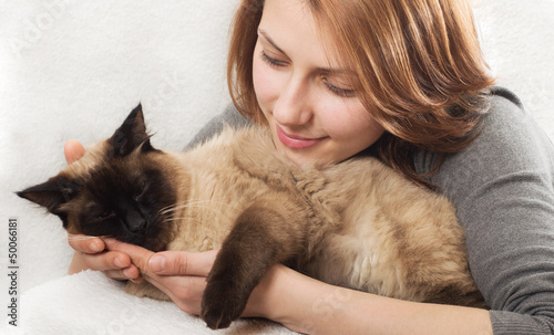 girl affectionately hugging  kitten