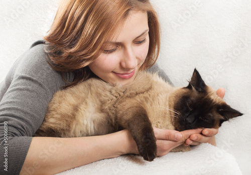 cute girl affectionately hugging  kitten