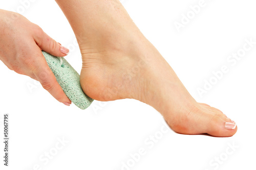 Woman having her foot scrubbed, isolated on white