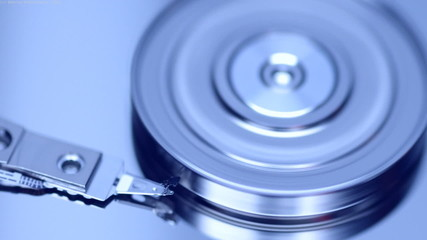 Closeup view of working hard disk drive.