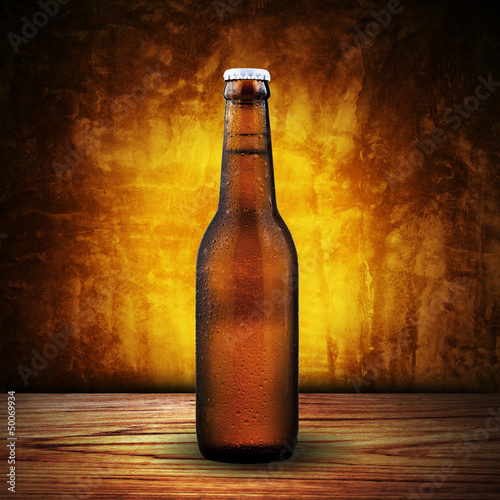 bottle of beer on wood table