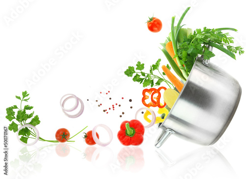 Fresh vegetables coming out from a stainless steel casserole pot