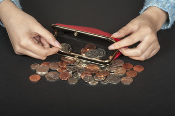 Woman's hand handling money in a purse