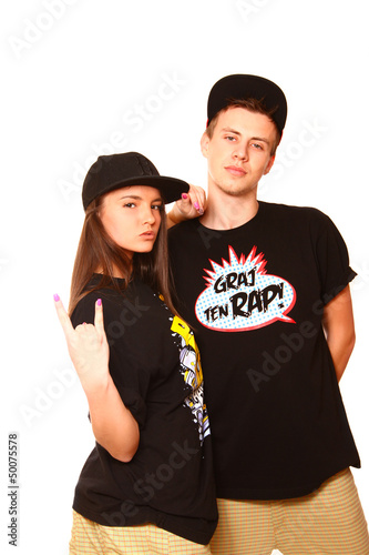 Cool boy and girl hip hop dancer posing on white background