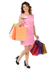 Beautiful woman with credit card and shopping bags isolated on w