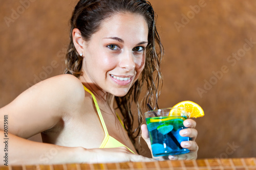 Woman relaxing in a spa with a cocktail
