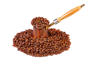 Old turkish copper coffee pot full of coffee beans and cofee bea