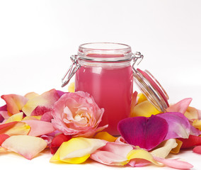 Aromatic rose water and petals