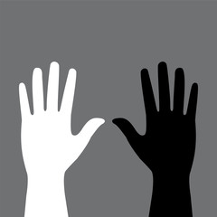 two colored hands on a gray background