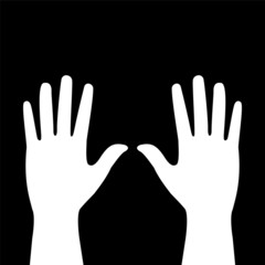 two hands on a black background