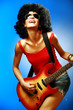 Sensual woman playing on the electric guitar