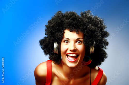 Happy woman with afro hairstyle wear headphones