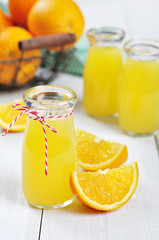 Orange juice in glass jars