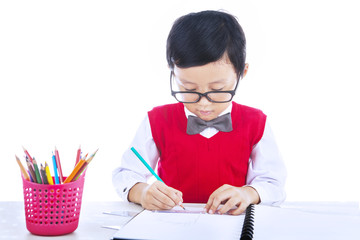 Boy drawing isolated on white