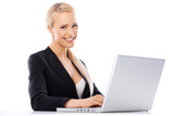 Cute blond business woman working on laptop