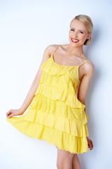 Pretty elegant woman wearing yellow dress