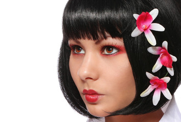 geisha makeup, beautiful girl with red flowers in her hair
