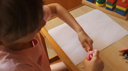 little girl sharpening pencils 6017