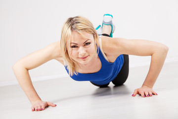 Sporty woman doing push ups
