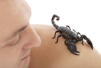 Man with scorpion on his shoulder