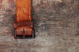 Leather belt on wooden background