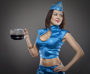 pretty young stewardess with coffee