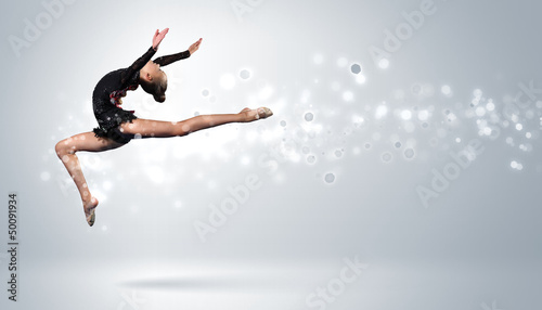 Foto op Canvas Dance School Young woman in gymnast suit posing
