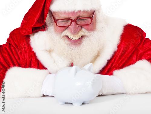 Weihnachtsmann betrachtet Sparschwein