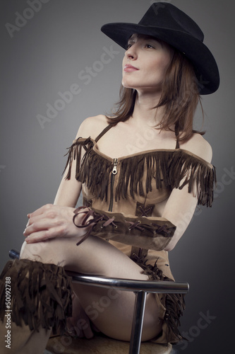 young beauty cowgirl studio shot