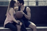 Beautiful young couple, kissing after physical activity