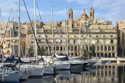 moored sailboats and waterfront of Senglea marina in front Vittoriosa, Malta
