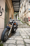 Motorcycle parked in a paved road of Corfu island, Greece