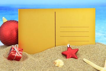 Christmas greeting card on the beach