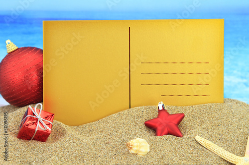 Christmas greeting card on the beach