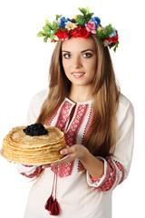 Ukrainian holds pancakes with caviar