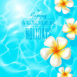 Tropical flowers floating on clear blue water