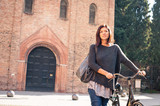 Woman portrait with bicycle in S. Stephen sq, Bologna, Italylt