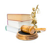 gavel, the statue of justice, and a stack of books isolated on w