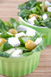 Green greek salad with olive, corn and feta