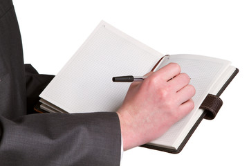 Businessmans hand holding a pen requesting a signature on a docu