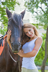Portrait of a young girl with a horse. Focus on horses face.