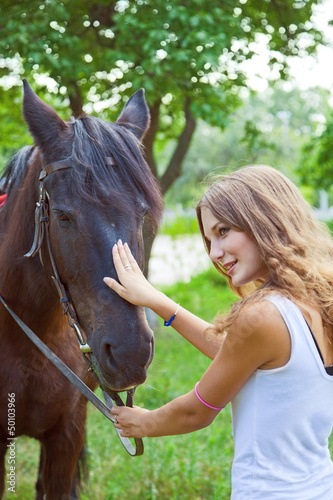 Young girl to train a horse.Focus on horses face.